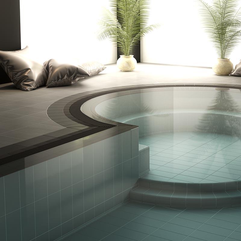 Piscina spa con gres porcelánico Aqua Blanco de Rosa Gres