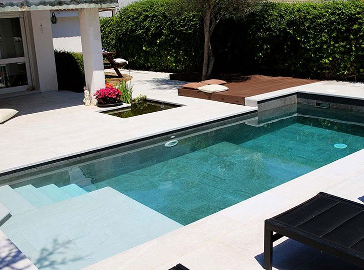 A classic improvement: black and white pool and terrace