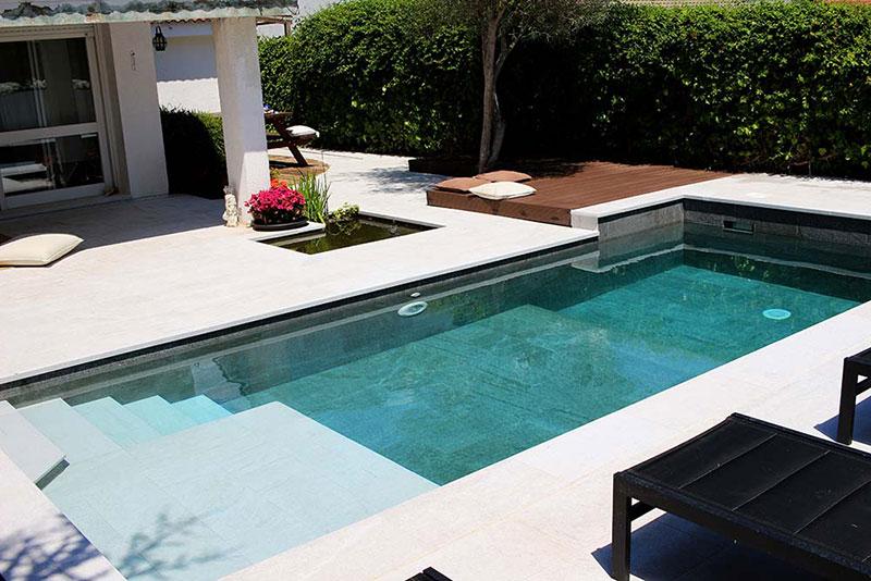 A classic improvement black and white pool and terrace for Gres de breda para piscinas