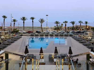 View of the pool and the Rosa Gres porcelain stoneware deck - Hotel Meliá Torremolinos