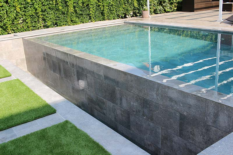Pool, wall, deck and terrace with a single color of tile - Mistery Blue Stone