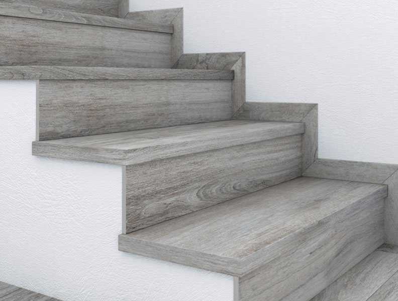 Stairs and baseboards in wood look tile - Porcelain Stoneware Alma Collection