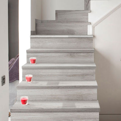 Stairs with wood look tile flooring in porcelain stoneware - Alma Mist
